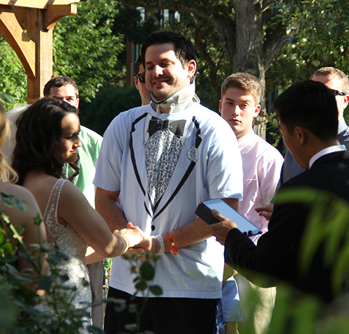 Brennan and Lisa Lazzaretto exchanging wedding vows in the Marianjoy Rose Garden