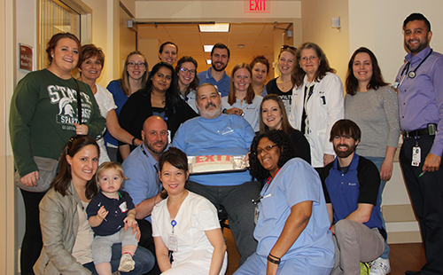 Scott Fisher surrounded by his Marianjoy Therapy Team before discharge home.