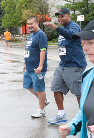 Marianjoy therapists walk the race with Hieu to show their support.